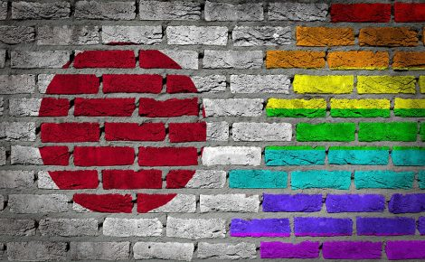 Dark brick wall texture - coutry flag and rainbow flag painted on wall - Japan